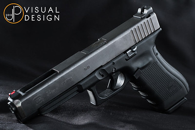 Just another Glock 34. This is the Gen 4 that I use in USPSA production class. Nothing fancy, just Warren Sevigny competition sights and a partial Ghost Rocket trigger kit.  My goal with this shot was to experiment with some different lighting.