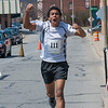 Dohnavan Leblanc celebrates as he crosses the finish line after crushing the field in the 2nd Annual Patriot's Day 5k sponsored by the Fitchburg Veterans' Council. SENTINEL&ENTERPRISE/ Jim Marabello