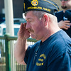 Fitchburg American Legion Post 429 Commander Jack Walker salutes during the playing of Taps during the Fitchburg Veterans' Council 2nd Annual Patriot's Day Program at Riverfront Park. SENTINEL&ENTERPRISE/ Jim Marabello