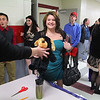 """Fitchburg High School sophomore Taylor Zisk donates a stuffed animal to the school at the """"Winter Dance"""" to help the Toys for Tots program.  The school collected over 200 toys with 100 dollars from the dance money and $200 from the teachers going to purchase many of the toys. If the kids brought in a toy they got half off their ticket. SENTINEL & ENTERPRISE/ JOHN LOVE"""
