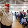 USMC veteran Dan Cunningham salutes during Fitchburg's Memorial Day service at the Senior Center on Monday morning. SENTINEL & ENTERPRISE / Ashley Green