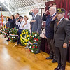City officials and veterans place the ceremonial wreaths during Fitchburg's Memorial Day service at the Senior Center on Monday morning. SENTINEL & ENTERPRISE / Ashley Green