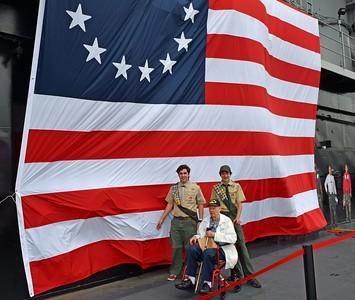 Eagle Scouts escort honored Vet, Mr. Clemons past 13 Star Flag