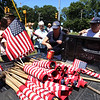 LAER Realty holds a Flag Take Down celebration and fundraiser for Massachusetts Fallen Heroes, to take down about 700 American flags to reuse next year. Volunteers roll up flags in to batches of dozens. (SUN/Julia Malakie)