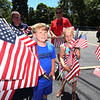 LAER Realty holds a Flag Take Down celebration and fundraiser for Massachusetts Fallen Heroes, to take down about 700 American flags to reuse next year. Nate Baer, 9, and his sister Ava Baer, 7, of Chelmsford. (SUN/Julia Malakie)