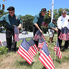 LAER Realty holds a Flag Take Down celebration and fundraiser for Massachusetts Fallen Heroes, to take down about 700 American flags to reuse next year. From left, Ken Vezina of Lowell, Bob Casper of Chelmsford, and Bill La Varnway of Dunstable. (SUN/Julia Malakie)