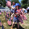 LAER Realty holds a Flag Take Down celebration and fundraiser for Massachusetts Fallen Heroes, to take down about 700 American flags to reuse next year. Shannon Crandall, 11, of Dunstable, front, and her friend Ella Dickinson, 11, of Groton. (SUN/Julia Malakie)