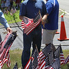 LAER Realty holds a Flag Take Down celebration and fundraiser for Massachusetts Fallen Heroes, to take down about 700 American flags to reuse next year. Gold Star father Kevin Woitowicz of Groton, whose son in the Marine Corps special ops died June 7, 2011 in Afghanistan. (SUN/Julia Malakie)
