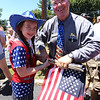 LAER Realty holds a Flag Take Down celebration and fundraiser for Massachusetts Fallen Heroes, to take down about 700 American flags to reuse next year. Shannon Crandall, 11, of Dunstable, and her father Jon Crandall, sales broker with LAER Realty. (SUN/Julia Malakie)
