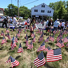 LAER Realty holds a Flag Take Down celebration and fundraiser for Massachusetts Fallen Heroes, to take down about 700 American flags to reuse next year. (SUN/Julia Malakie)