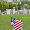 Volunteers placed flags on the graves of veterans at Laurel Hill Cemetery in Fitchburg, shown here on Saturday afternoon. SENTINEL & ENTERPRISE / Ashley Green