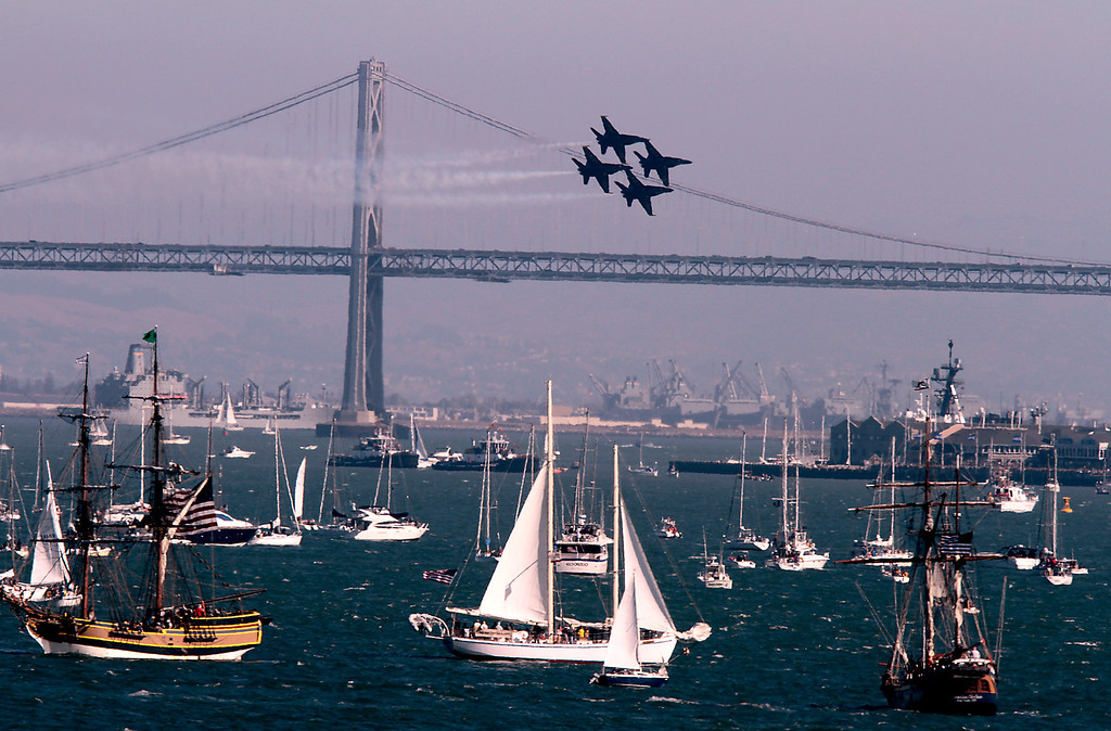 The Blue Angels fly by the Bay Bridge during Fleet week in San Francisco, Calif., on Saturday, October 8, 2011.