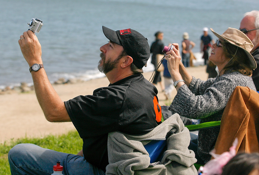 People shoot pictures of the Air Show over the bay during Fleet week in San Francisco, Calif., on Saturday, October 8, 2011.