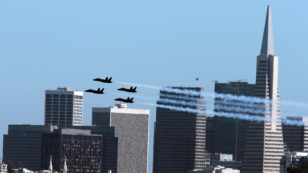 The Blue Angels fly over San Francisco and the bay during Fleet week in San Francisco, Calif., on Saturday, October 8, 2011.