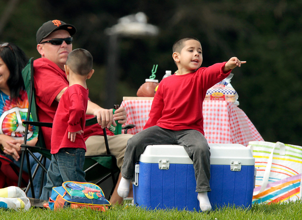 A little boy points the the planes over the bay during Fleet week in San Francisco, Calif., on Saturday, October 8, 2011.