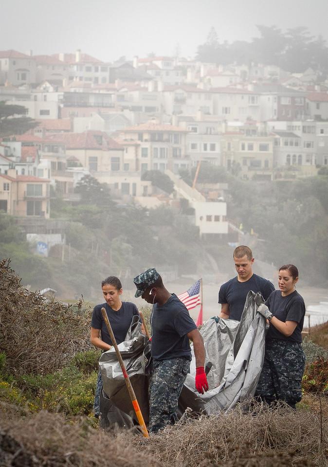 Navy personel perform habitat restoration at Baker Beach in San Francisco, Calif., on Saturday, October 8, 2011.