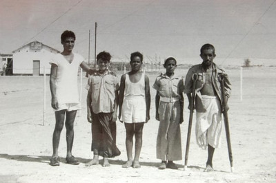 A civilian camel driver (RH end) was employed to move stores into the Liwa.  His camel got into a fight with another camel and he was badly bitten on the leg.  He was casevaced to Qatar by Pioneer and thence to civilian hospital in Bahrain, where they amputated most of his leg.  This picture was taken after he hopped off a Valetta at Sharjah.  He thought it was all a huge joke.  Some joke......                                                                                                                              (DMC)