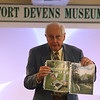Armed Forces Day at Fort Devens Museum. Dave Gordon of Groton, a volunteer and past president of the Fort Devens Museum, show photos of graves of soldiers at Devens who died in the 1918 flu pandemic. (SUN/Julia Malakie)