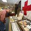 Armed Forces Day at Fort Devens Museum. Allan Wilson of Ayer looks a museum displays. (SUN/Julia Malakie)