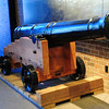 This 18-pounder Revolutionary War cannon (No. 1 of 12) was produced using 18th century guidelines for the United States Bicentennial celebration in 1976.  Used primarily at permanent fortifications or aboard ships, they could be reloaded in about six minutes by a crew of up to 16 men.  They had an accurate range of 1,800 yards (1.02 miles) but could reach up to 4,000 yards (2.25 miles).  The standard cannonball was a solid 18-pound shot, but exploding shells, spherical case shot, canister, grapeshot and others could also be used.  The powder charge was 4.5 pounds.  The 9 foot barrel weighs 4,660 pounds.