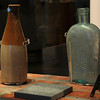 the ceramic bottle on the left held beer and the glass flask came from the hospital.