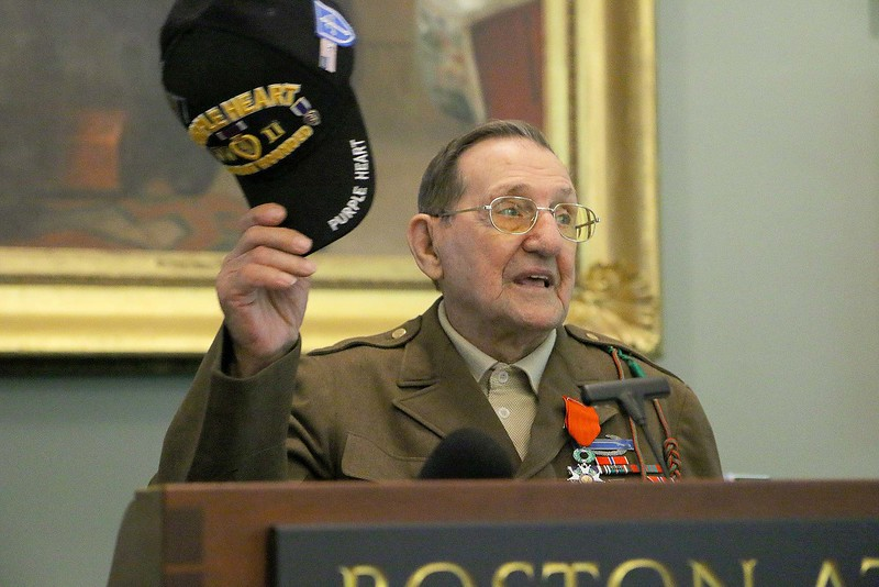 Frank Polewarczyk, 91, a WWII veteran, thanks everyone at the Boston Athenæum after receiving France's highest military metal, the Legion of Honor. SUN/JOHN LOVE