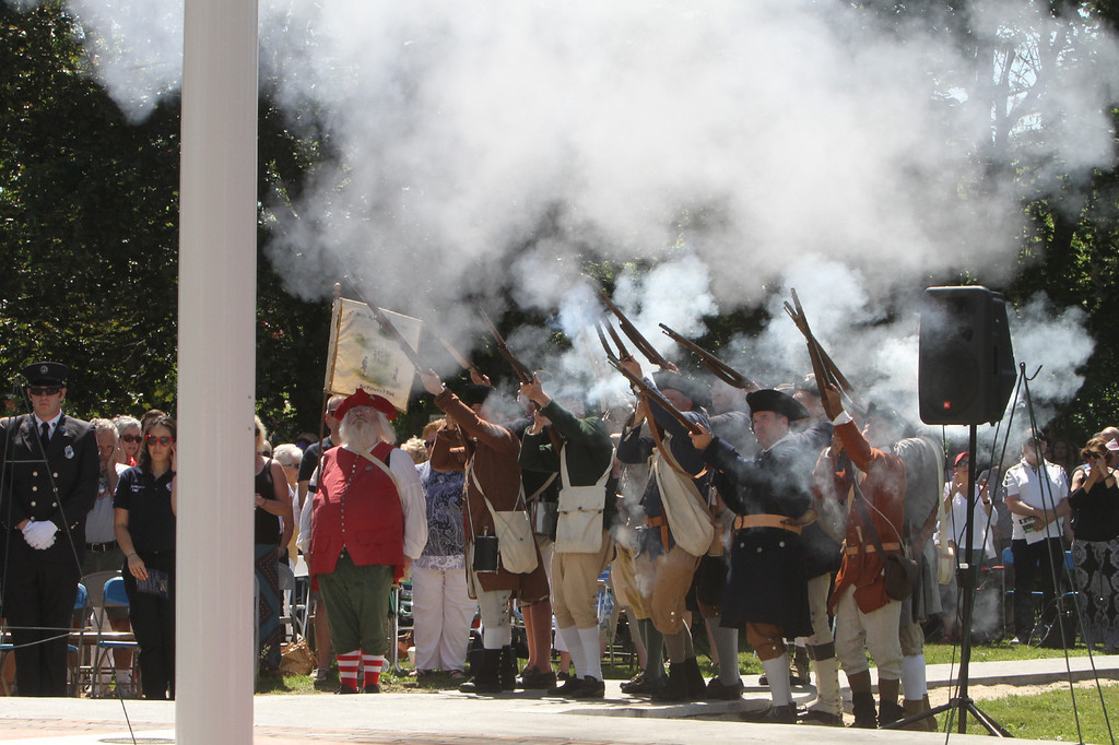 . Dedication ceremony for the Middlesex G.W.O.T. Veteran\'s Monument in Pepperell, honoring service members who sacrificed in the post 9/11 Global War on Terror. 6th Middlesex Regiment fires a salute. (SUN/Julia Malakie)