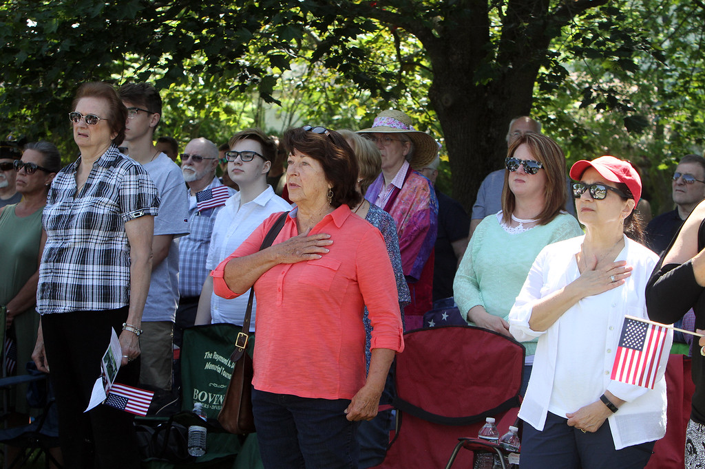. Crowd stands for National Anthem during dedication ceremony for the Middlesex G.W.O.T. Veteran\'s Monument in Pepperell, honoring service members who sacrificed in the post 9/11 Global War on Terror. (SUN/Julia Malakie)