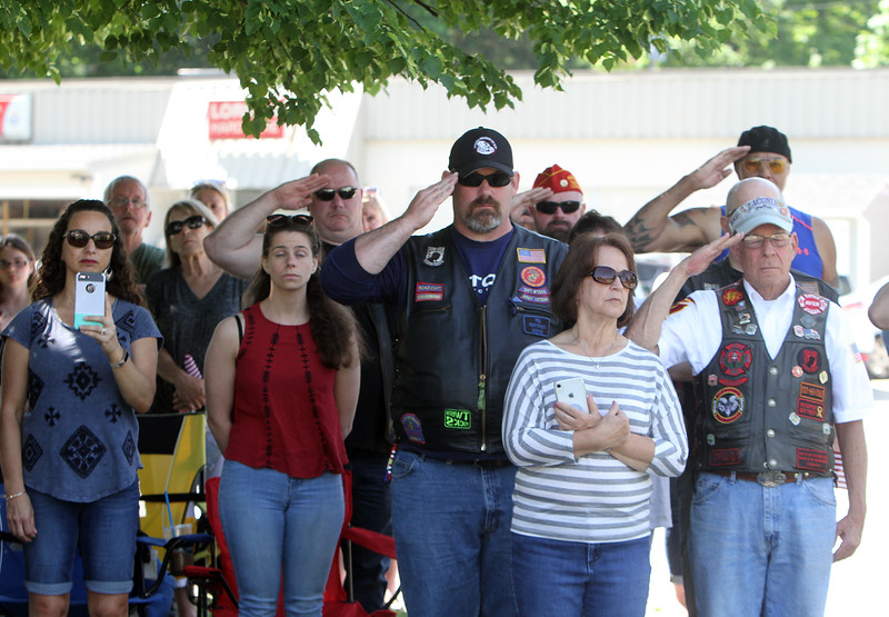 Crowd stands for National Anthem during dedication ceremony for the Middlesex G.W.O.T. Veteran's Monument in Pepperell, honoring service members who sacrificed in the post 9/11 Global War on Terror. (SUN/Julia Malakie)