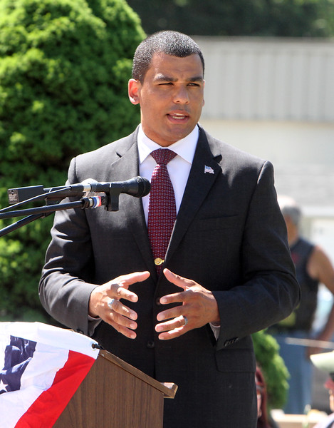 Dedication ceremony for the Middlesex G.W.O.T. Veteran's Monument in Pepperell, honoring service members who sacrificed in the post 9/11 Global War on Terror. Massachusetts Dept. of Veterans' Services secretary Francisco Urena speaks. (SUN/Julia Malakie)