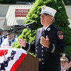 Dedication ceremony for the Middlesex G.W.O.T. Veteran's Monument in Pepperell, honoring service members who sacrificed in the post 9/11 Global War on Terror. Captain Eugene Kananowicz, retired from FDNY, speaks at ceremony. (SUN/Julia Malakie)