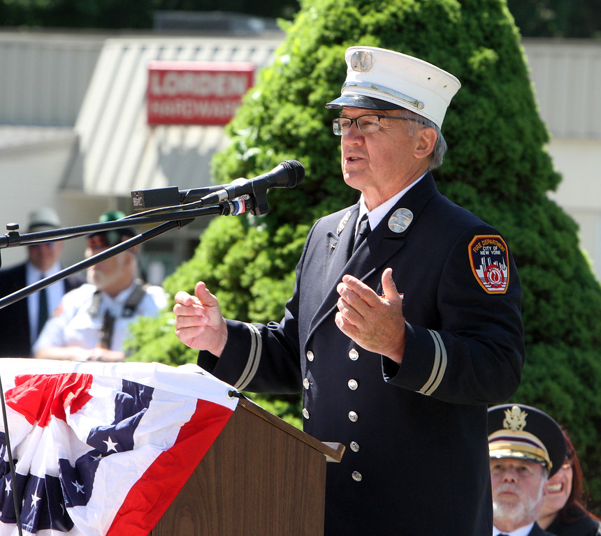 . Dedication ceremony for the Middlesex G.W.O.T. Veteran\'s Monument in Pepperell, honoring service members who sacrificed in the post 9/11 Global War on Terror. Captain Eugene Kananowicz, retired from FDNY, speaks at ceremony. (SUN/Julia Malakie)