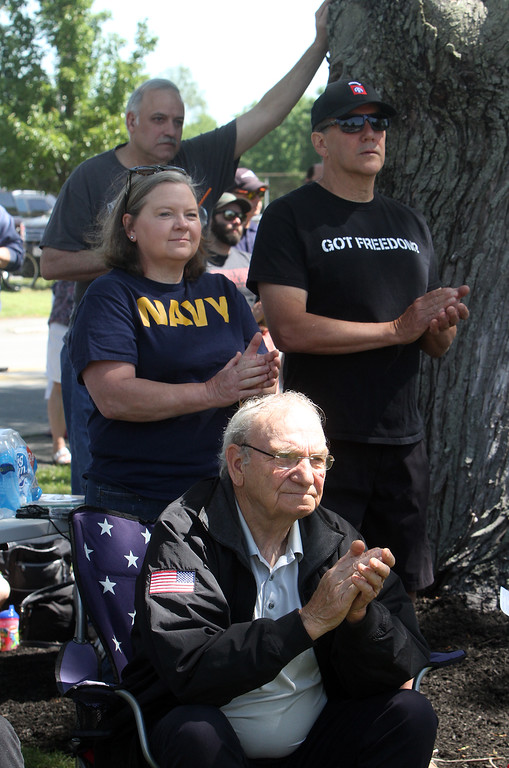 . Dedication ceremony for the Middlesex G.W.O.T. Veteran\'s Monument in Pepperell, honoring service members who sacrificed in the post 9/11 Global War on Terror. Mike Krygowski of Rindge, N.H., front, and Christine and husband Dennis Brooks of Pepperell, center. (SUN/Julia Malakie)