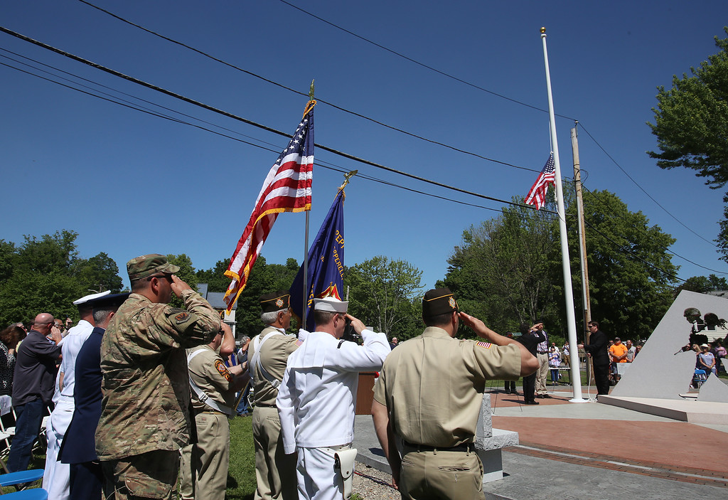 . Raising of flag at dedication ceremony for the Middlesex G.W.O.T. Veteran\'s Monument in Pepperell, honoring service members who sacrificed in the post 9/11 Global War on Terror. (SUN/Julia Malakie)