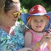 """Dedication ceremony for the Middlesex G.W.O.T. Veteran's Monument in Pepperell, honoring service members who sacrificed in the post 9/11 Global War on Terror. Martha """"Marti"""" Murphy of Merrimack, N.H., with granddaughter Mia Terris of Dracut. (SUN/Julia Malakie)"""