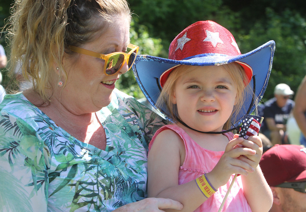 """. Dedication ceremony for the Middlesex G.W.O.T. Veteran\'s Monument in Pepperell, honoring service members who sacrificed in the post 9/11 Global War on Terror. Martha \""""Marti\"""" Murphy of Merrimack, N.H., with granddaughter Mia Terris of Dracut. (SUN/Julia Malakie)"""
