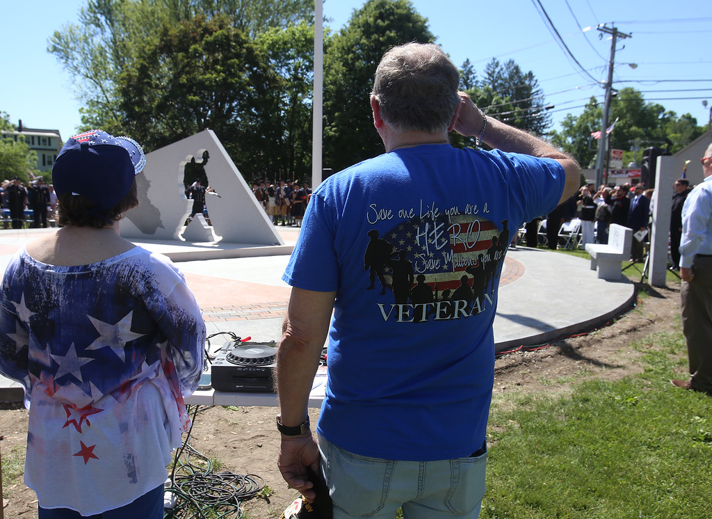 . Dedication ceremony for the Middlesex G.W.O.T. Veteran\'s Monument in Pepperell, honoring service members who sacrificed in the post 9/11 Global War on Terror. Darlene and husband Don Coutu of Pepperell. (SUN/Julia Malakie)