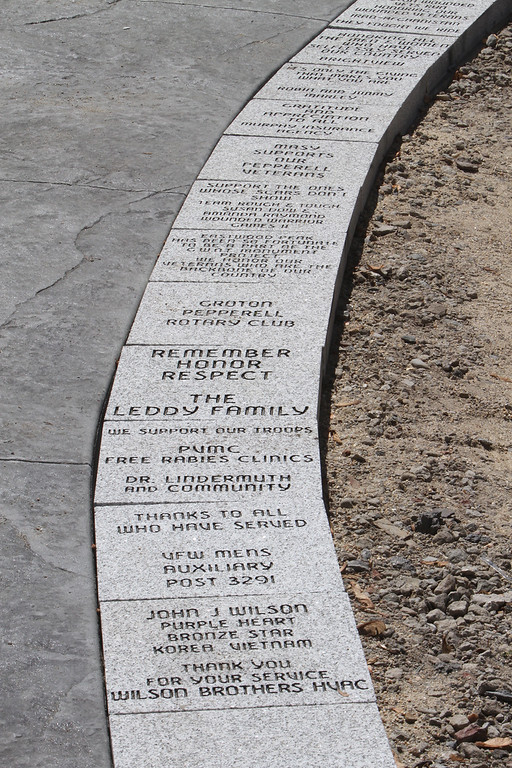 . Dedication ceremony for the Middlesex G.W.O.T. Veteran\'s Monument in Pepperell, honoring service members who sacrificed in the post 9/11 Global War on Terror. Sponsored blocks along the walkway.(SUN/Julia Malakie)
