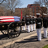 A funeral procession for retired Gen. Carl E. Mundy, Jr., the 30th Commandant of the Marine Corps, takes place on the way to the Marine Corps War Memorial in Arlington, Va., on April 12, 2014. (U.S. Marine Corps photo by Sgt. Marionne T. Mangrum)