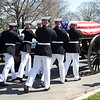 Marine Corps Body Bearers place the flag draped coffin of retired Gen. Carl E. Mundy, Jr., the 30th Commandant of the Marine Corps, on to the caisson for his memorial ceremony at the Marine Corps War Memorial, in Arlington, Va., on April 12, 2014. (U.S. Marine Corps photo by Sgt. Marionne T. Mangrum)