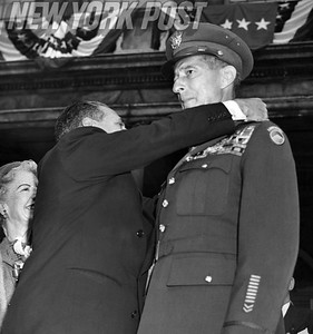 Gen. Mark Clark gets City Honor Medal from Mayor Vincent R. Impellitteri. October 20, 1953.