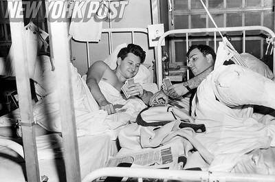 Wounded Veterans PFC. Herbert Schwartz (left) and Cpl. Barney Berck play cards in Halloran Hospital. 1946