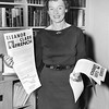 Eleanor Clark French Holding Up Flyers. 1956