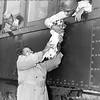 Rachel Dabner holding up Spot for her nephew Pandy Pobertson. 1950