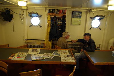 MEMORY LANE - Two O'Brien volunteers reminisce about the past. Notice the portholes, radiators and bulkhead-mounted three-bladed fan.