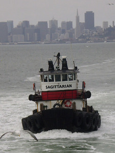 TUG ESCORT - The tug 'Sagittarian' accompanied the O'Brien to the Ghost Fleet and back. Photo by Will Stockwin