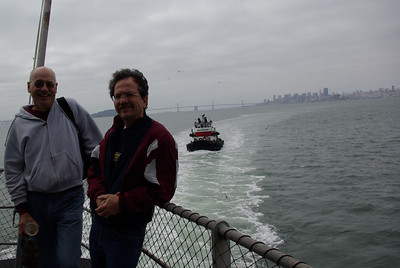 EX-SAILORS (July 24, 2011) -- Will, Ray and tugboat Sagitarian share the San Francisco skyline.
