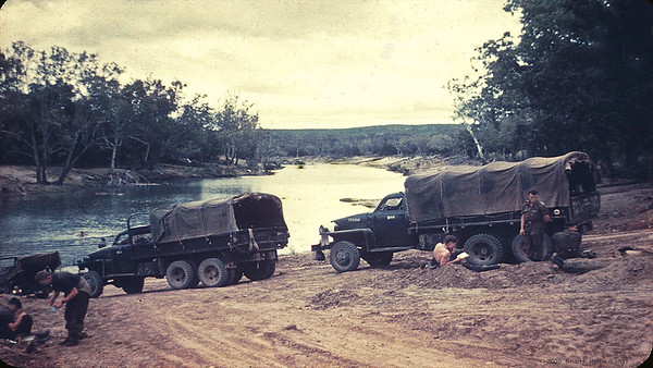 We had finished the Grand Slam exercise in North Queensland (Koumala) in 1959 and are slowly making our way back down south to Victoria. Time for a casual lunch break and 'kick the tyres'. The Studebakers are very basic on the mechanical side, just so reliable but very rough without a heavy load. The sporty lift up windscreen is fun and breezy. Left hand drive with a mechanical hand on the right for turns in traffic. We once drove one Stude up to touch rear of front one and a guy got through the windscreen opening, climbed along the bonnet and into the rear of the front truck.  All on Ipswich Road four lane. Boys will be boys ;-)