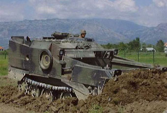 The M-9 is a highly mobile, full-tracked, air transportable armored earthmover.