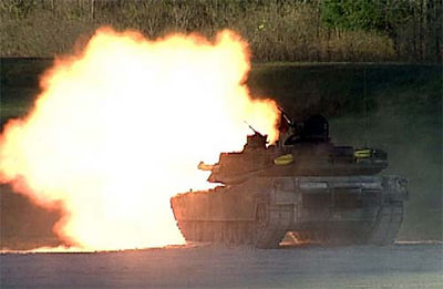 AN M1 Abrams tank fires a new M1028 canister round.